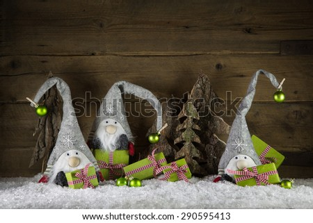 Funny handmade christmas decoration in red, white, green, brown and red with presents, imps and balls. - stock photo