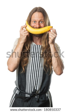 Funny, happy hippie man holding a banana over his mouth as a smile. Isolated on white. - stock photo