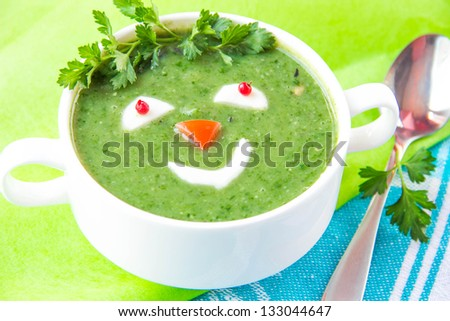 Funny healthy soup with spinach for children - stock photo