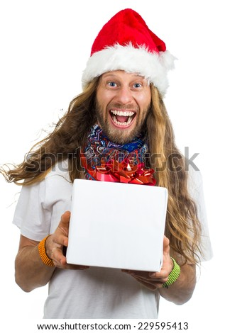 Funny hippie man in Santa hat holding giving a Christmas gift isolated on white background - stock photo