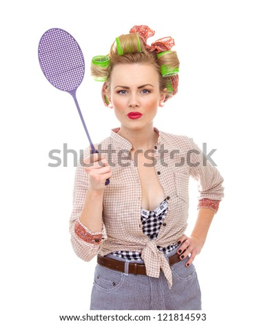 Funny housewife / girl with fly swatter, isolated on white. - stock photo