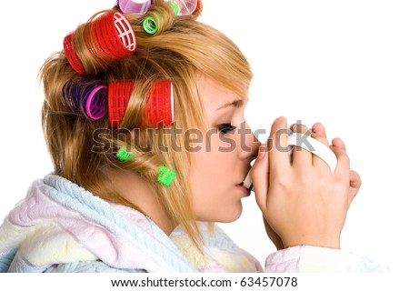 funny housewife with curlers and cup on white background - stock photo
