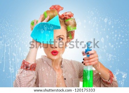 Funny housewife with rag / wipe and cleaning spray for window. Foam / soap on glass - stock photo