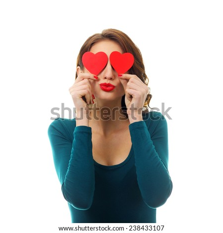 Funny Joyful Girl with Valentine Hearts over her Eyes. Laughing Young Woman in love. Isolated on a White Background - stock photo