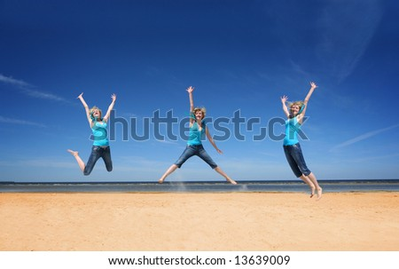 funny jumping girl near the sea - stock photo
