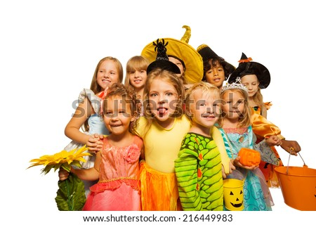 Funny kids in Halloween costumes - stock photo