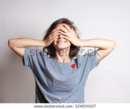 Funny lifestyle portrait of crazy girl closed her eyes,emotional and happy mood, - stock photo