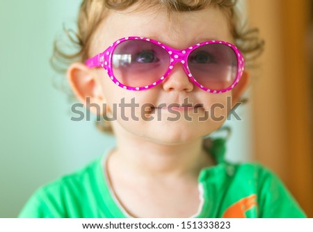 funny little baby with glasses - stock photo
