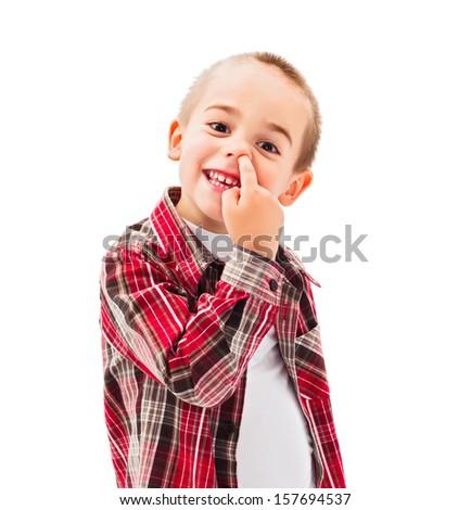 Funny little boy enjoying picking his nose - stock photo