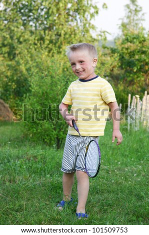 Funny little boy playing in badminton - stock photo