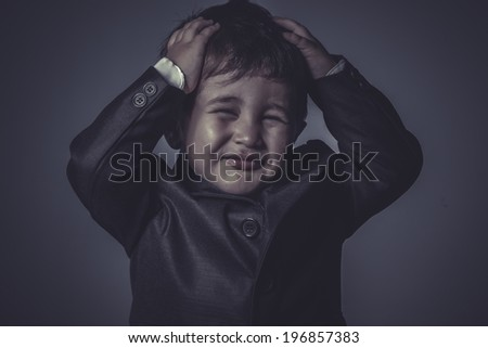 funny little business boy over grey background - stock photo