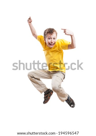 Funny little child jumping and laughing pointing with his index finger over white background  - stock photo