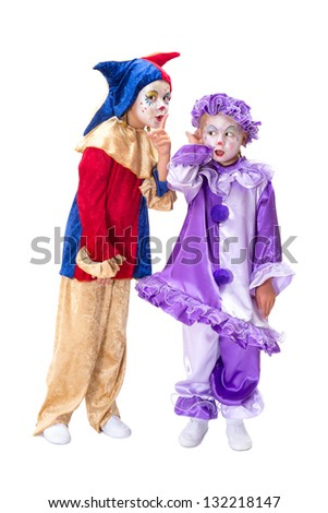 Funny little girl clowns whispering and talking gossip - stock photo