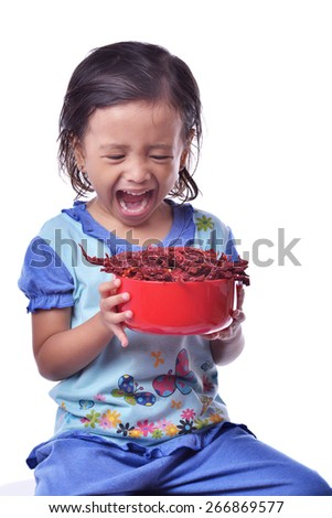 funny little girl holding dry pepper or children holding dried pepper, shouting, isolated on white - stock photo