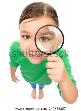 Funny little girl is looking through magnifier, fisheye portrait, isolated over white - stock photo