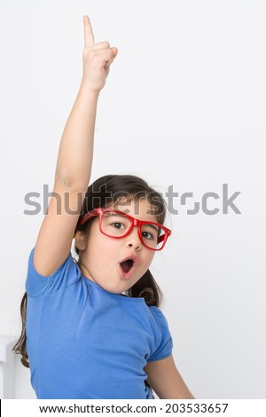 funny little girl lifting hand up. small girl shouting and wearing glasses - stock photo