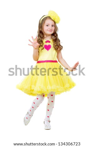 Funny little girl wearing nice yellow dress. Isolated on white - stock photo