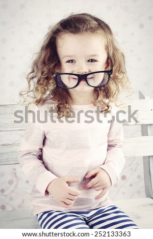 Funny little girl with glasses - stock photo