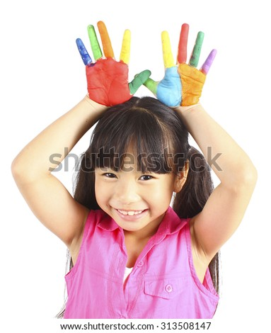 Funny little girl with hands painted in colorful paint - stock photo