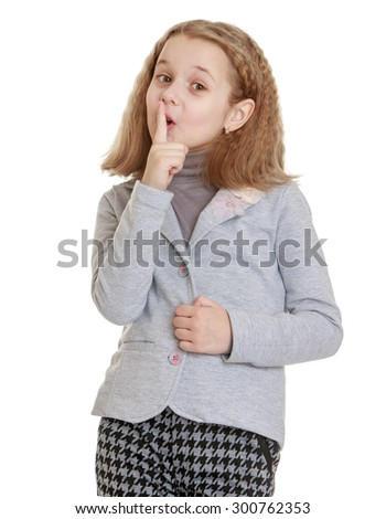 Funny little girl with short blond hair . The girl is dressed in a gray jacket and brown pants funny girl opened her mouth and put her hand to his lips in imitation of the gesture of silence-Isolated - stock photo