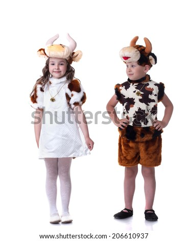 Funny little kids posing in carnival costumes - stock photo