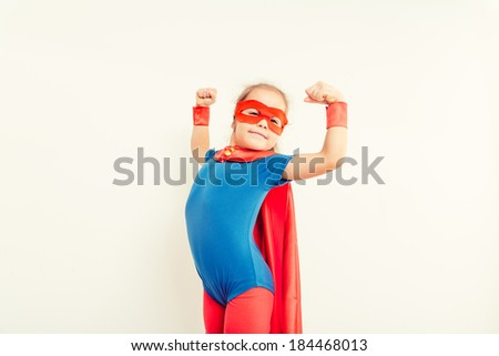 Funny little power super hero kid  (girl) in a blue raincoat. Superhero concept - stock photo
