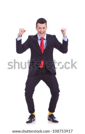 funny looking business man in suit and yellow socks, winning on white background - stock photo