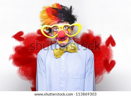Funny Looking Clown Watching A Romantic Comedy Wearing Heart Shaped Glasses In A Depiction Of Entertainment Love - stock photo