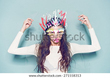Funny make-up on woman face photo on blue background - stock photo