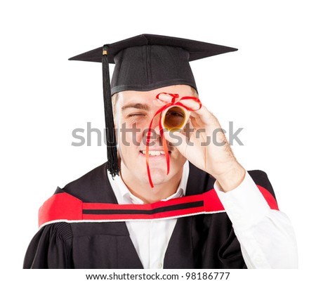 funny male graduate looking through certificate - stock photo
