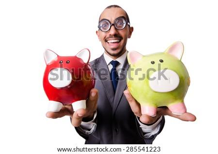 Funny man breaking his piggy bank - stock photo