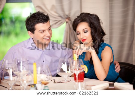 funny man flirting, woman borred restaurant table - stock photo