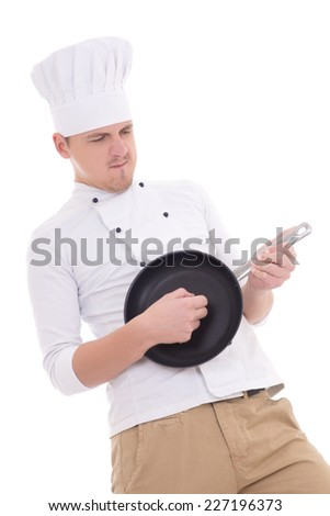 funny man in chef uniform playing frying pan like a guitar isolated on white background - stock photo