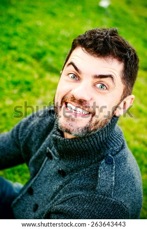 Funny man is smiling with white teeth and open mouth - stock photo
