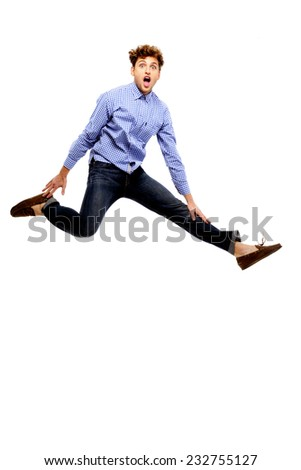 Funny man jumping over white background - stock photo