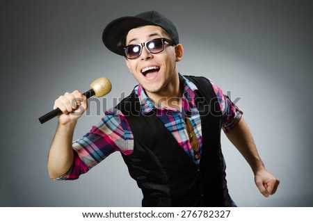 Funny man singing in karaoke - stock photo