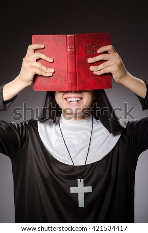 Funny man wearing nun clothing - stock photo