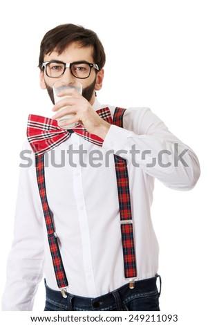 Funny man wearing suspenders drinking milk. - stock photo