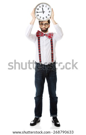 Funny man wearing suspenders holding big clock. - stock photo