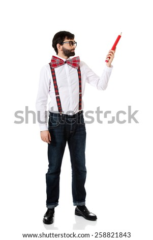 Funny man wearing suspenders pointing up with big pencil. - stock photo