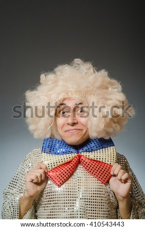 Funny man with afro wig - stock photo