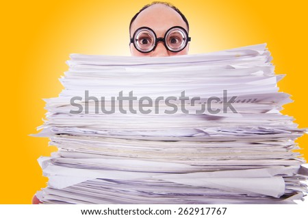 Funny man with lots of folders on white - stock photo
