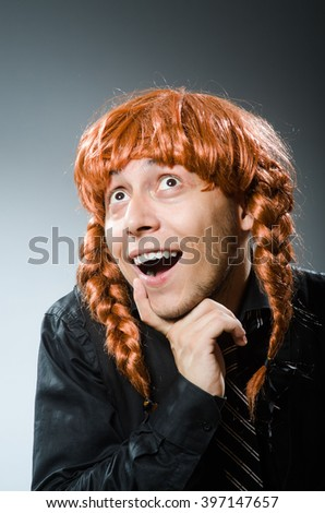 Funny man with red hair wig - stock photo
