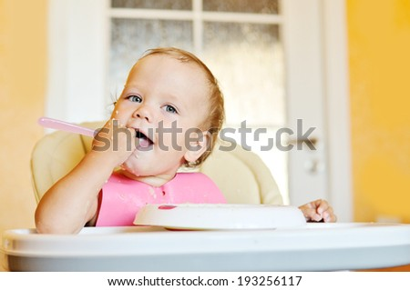 funny meal of dirty baby girl - stock photo