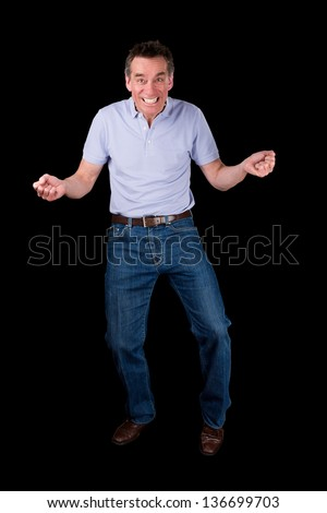 Funny Middle Age Man Dancing with Cheesy Grin Black Background - stock photo