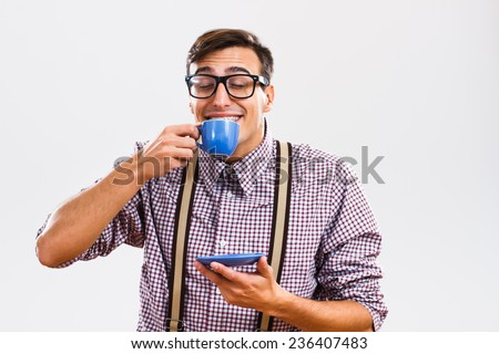 Funny nerd guy enjoys drinking coffee.Mmmm coffe! - stock photo