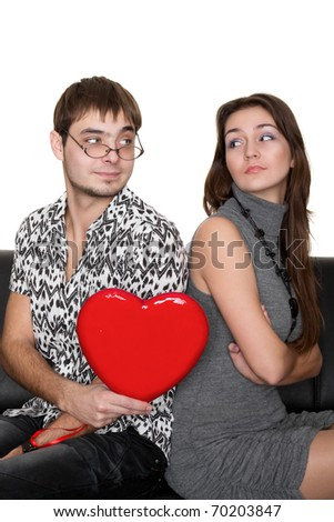 funny nerd guy gives a valentine glamorous girl isolated on white - stock photo