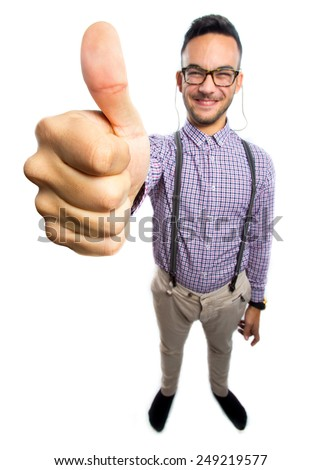 Funny nerd with giant hand and thumb up - stock photo