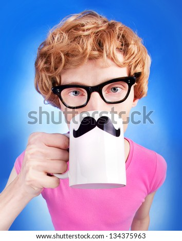 Funny nerdy guy drinking tea - stock photo
