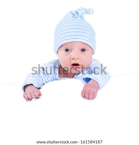 Funny newborn baby boy playing on his tummy, isolated on white with space for your text - stock photo